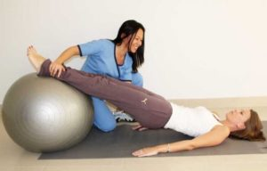 a woman doing exercise with her female physiotherapist