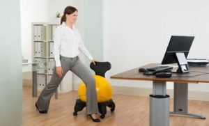 woman exercising at desk