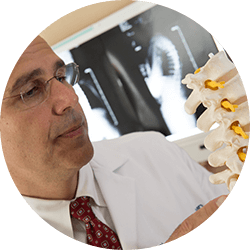 Dr. Charles Gatto examines lumbar spine model
