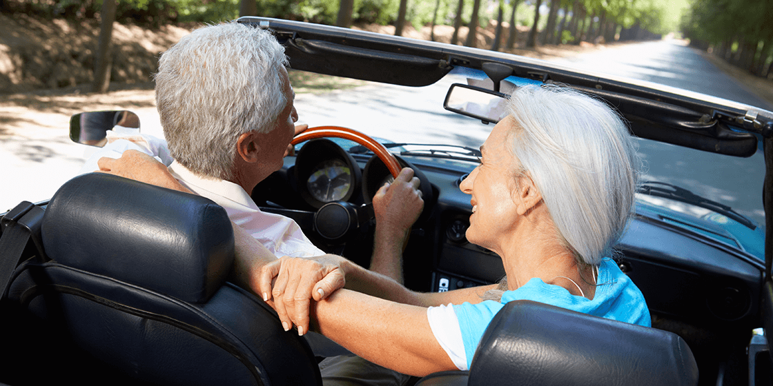happy couples drives in convertable without back pain