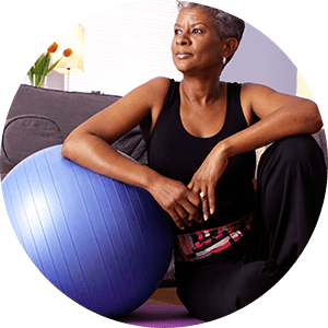 woman exercising at home with yoga ball