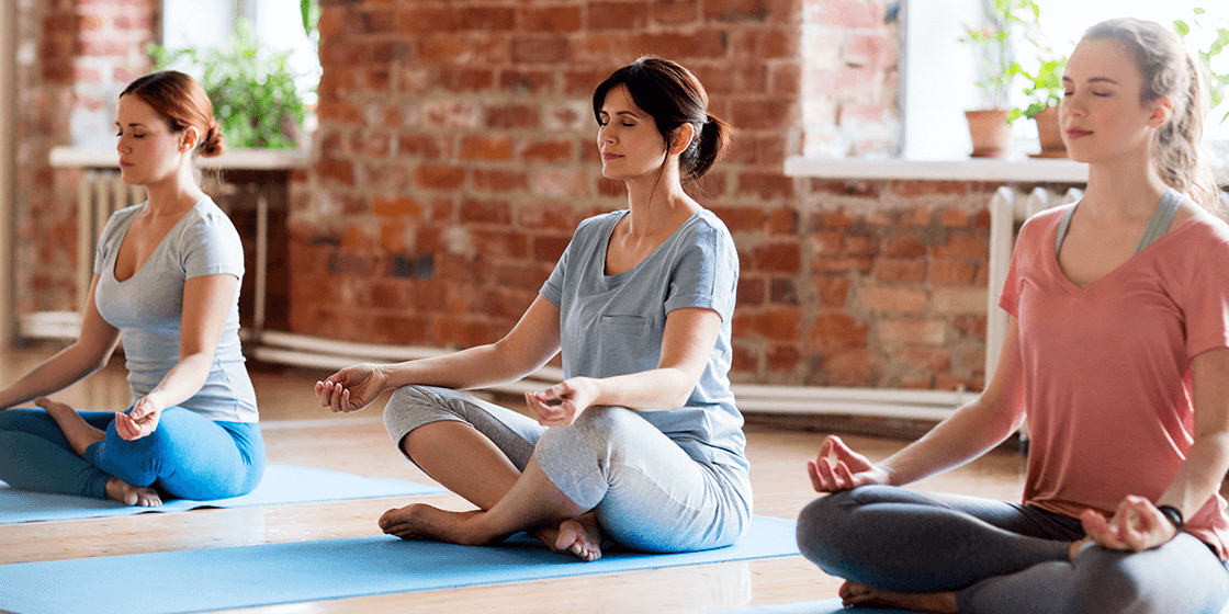 woman participates in yoga for back pain relief
