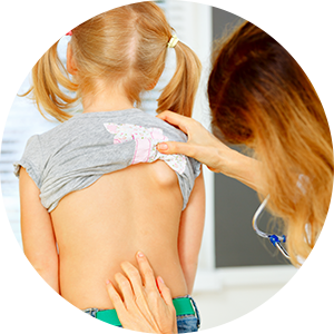 child being examined by doctor for pediatric spine problems