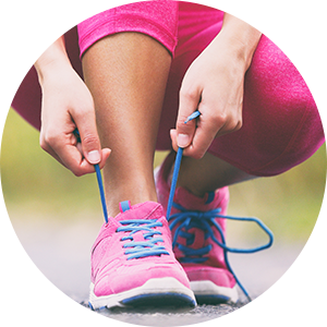 woman tying shoes before running to ease back pain