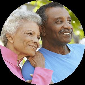 senior couples takes break from sciatica stretches