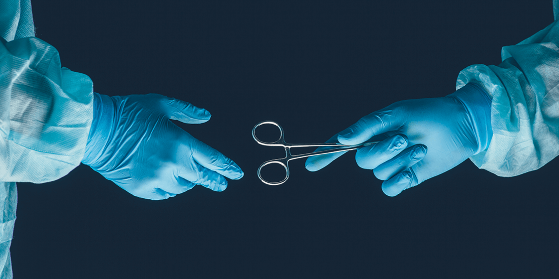 surgeon hands off surgical clamp