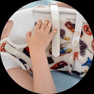 child undergoing scoliosis bracing
