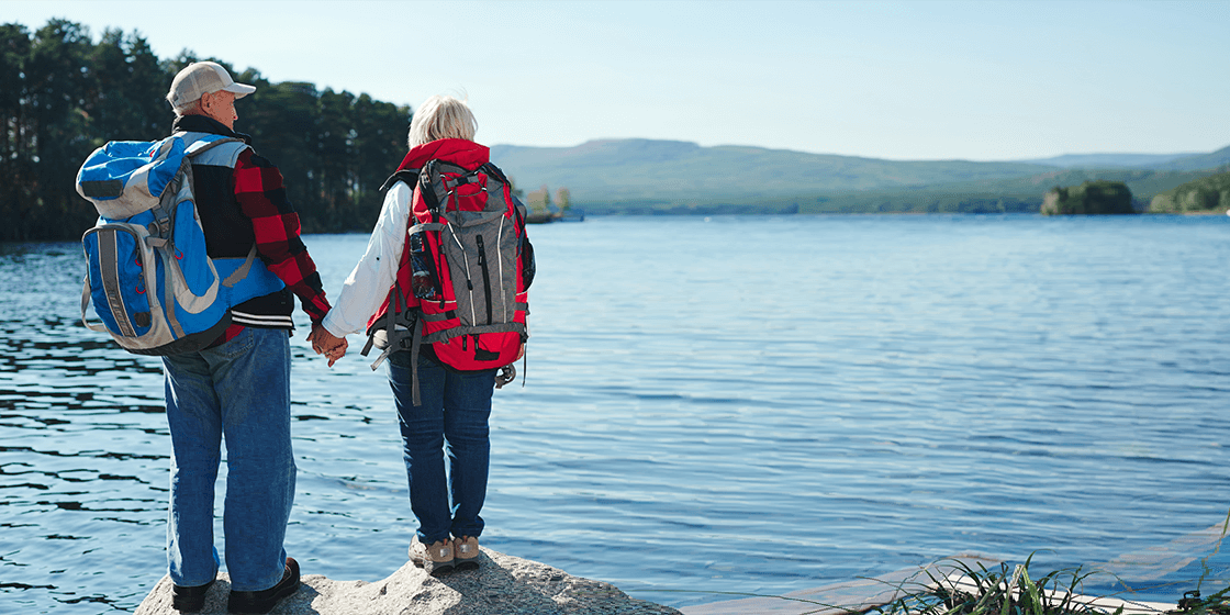 senior couple on hike after overcoming bone disease