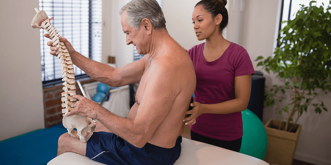 patient with lumbar herniated disc meets with physical therapist