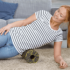 woman with sacroiliac joint dysfunction uses foam roller