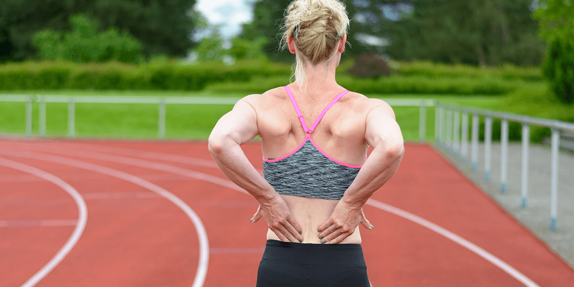 woman with lower back pain from fibromyalgia