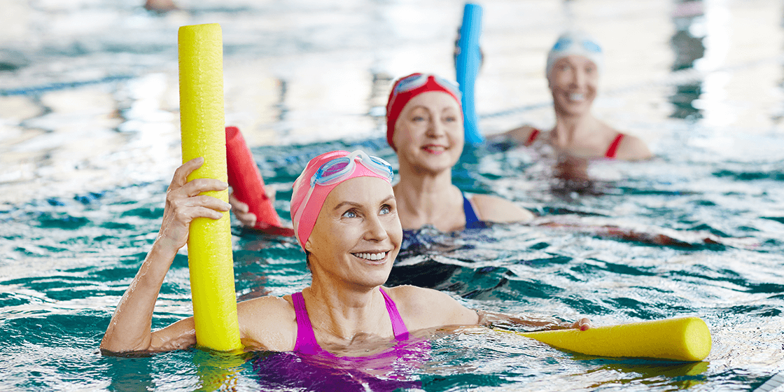 woman in water aerobics class for arthritis pain