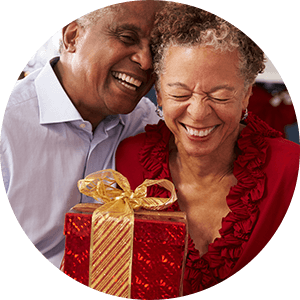 husband and wife exchanging gifts for back pain