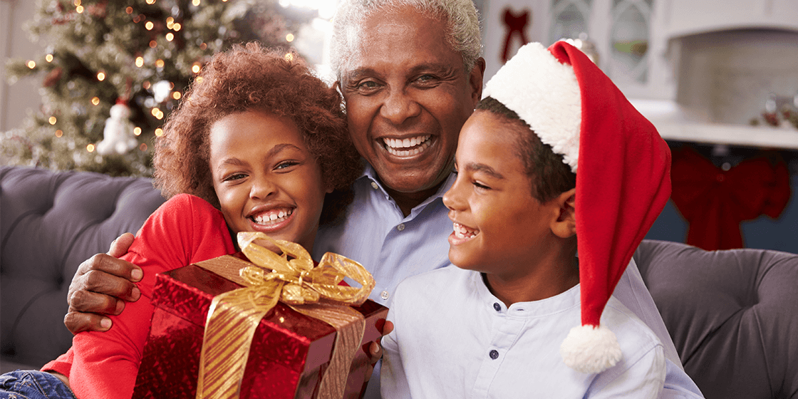 grandfather holding gift for back pain from grandchildren