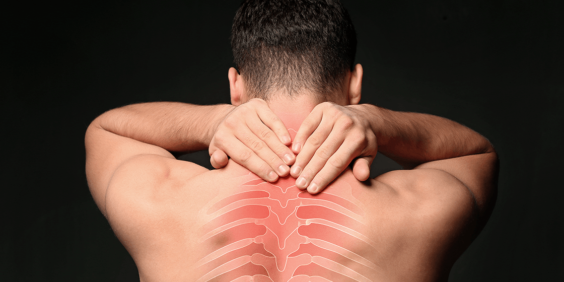 man with facet joint pain